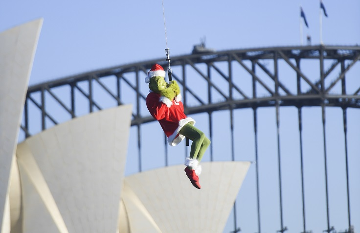 In A Sydney Harbour First 'The Grinch' Is Winched From A Helicopter To Steal The Fun From Carnival Spirit