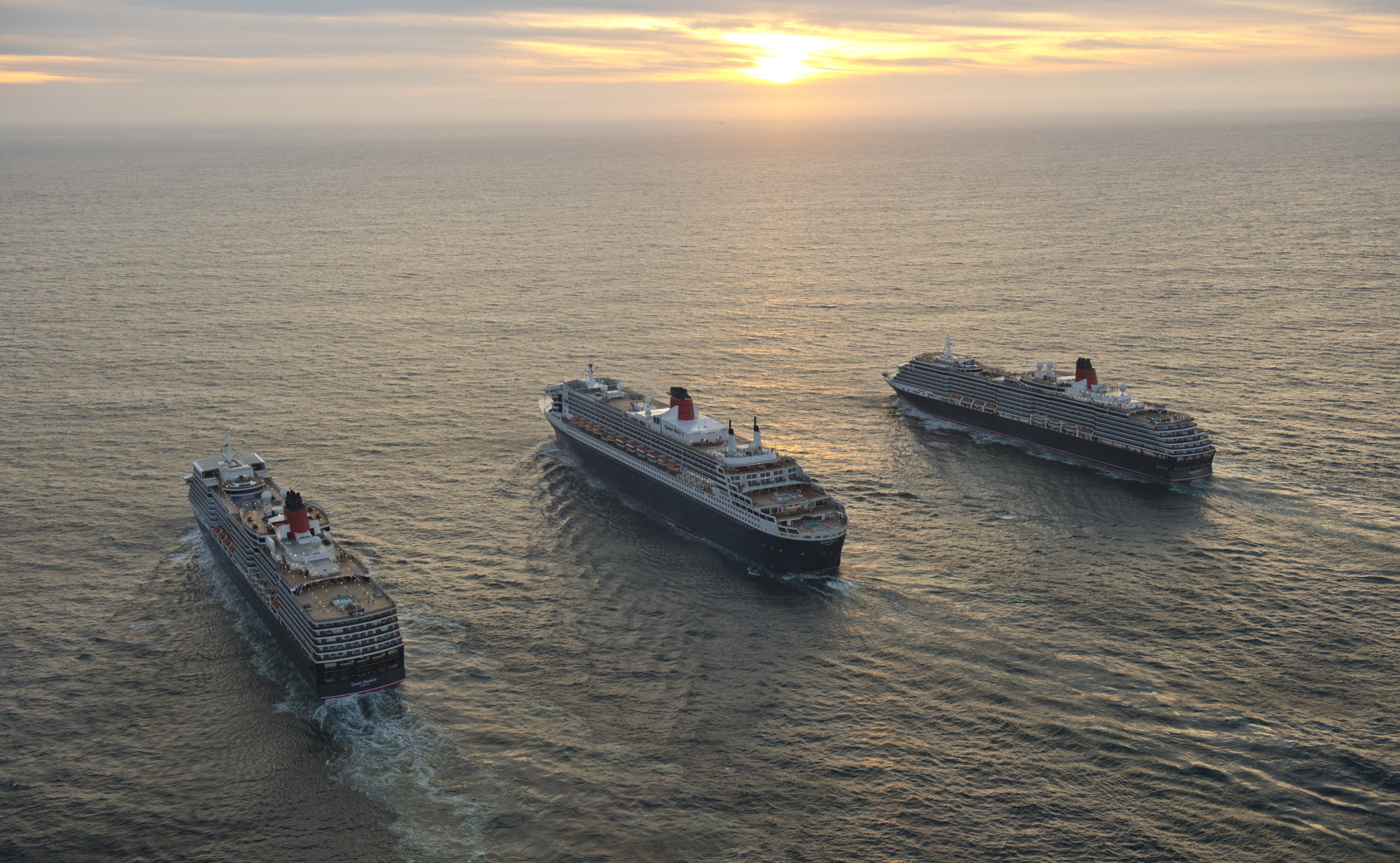Cunard's magnificent Queens lined up three abreast for the first time at sea